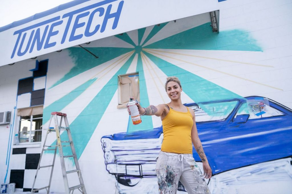 Woman Painting the mural at TuneTech